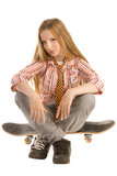Sitting on skateboard Stock Images