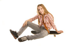 Sitting on skateboard Stock Image