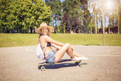 Sitting on the skateboard Stock Photography