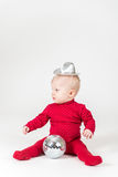 Sitting smiling baby in red with party ball Stock Photography