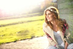 Sitting and Smiling Fashion Model Royalty Free Stock Photo