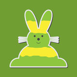 Sitting smiling greenish yellow Easter bunny Stock Photo