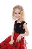 Sitting smiling little girl Royalty Free Stock Photo