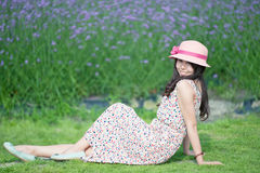 Sitting in the smoked clothing bushes, the girl Stock Image