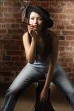 Sitting and smoking cigar Stock Image