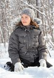 Sitting on snow. Women sitting on snow in nature Royalty Free Stock Photo