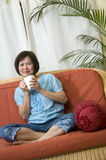 Sitting on the sofa Royalty Free Stock Images