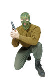 Sitting soldier with a handgun Stock Images
