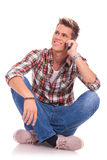 Sitting and speaking on phone Royalty Free Stock Photo
