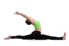 Sitting in splits yoga exercise Stock Photos