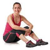 Sitting sporty girl have break. Dreamy smiling sporty woman resting after training. sitting Royalty Free Stock Photos