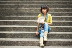Sitting on steps Royalty Free Stock Image