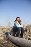 Sitting on a stump Royalty Free Stock Photo