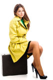 Sitting on suitcase Stock Photos