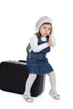 Sitting on a suitcase girl calls by phone Stock Photos