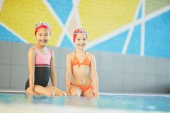 Sitting by swimming-pool Royalty Free Stock Photo