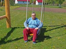 Sitting on swing Royalty Free Stock Images