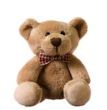 Sitting teddy bear. Isolated on a white royalty free stock photos
