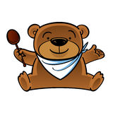 Sitting teddy bear with wooden spoon Royalty Free Stock Image