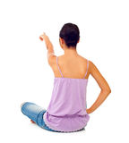 Sitting teen girl while pointing with her finger Stock Image