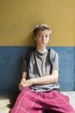 Sitting teenage boy Stock Photos