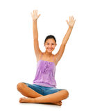 Sitting teenage girl while rejoices with arms up. Stock Photography
