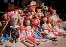 Sitting textile handmade dolls. Sale on city fair royalty free stock photography