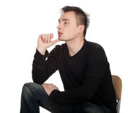 Sitting thoughtful young man Royalty Free Stock Photo