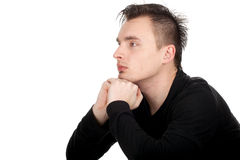 Sitting thoughtful young man Stock Images