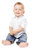 Sitting toddler. Smiling country baby-boy. Isolated Royalty Free Stock Photos