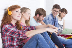 Sitting together on a break. Group of young students sitting together on a break at college Stock Photography