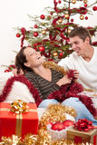 Sitting together in front of Christmas tree Royalty Free Stock Photography