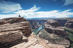 Sitting on the top of the Horseshoe Bend on Colorado River Royalty Free Stock Image
