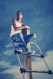 Sitting on top Royalty Free Stock Photo