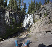 Tired sitting tourist watching the waterfall Royalty Free Stock Photography