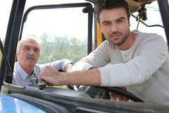 Sitting in tractor Stock Photography