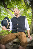 Sitting traditional Bavarian man Stock Images