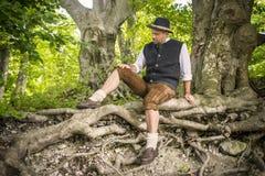 Sitting traditional Bavarian man Royalty Free Stock Photos