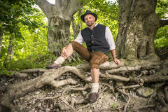 Sitting traditional Bavarian man Stock Image