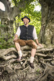 Sitting traditional Bavarian man Stock Photography
