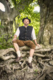 Sitting traditional Bavarian man Royalty Free Stock Photos