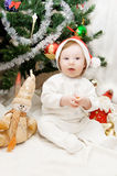 Sitting under Christmas tree Royalty Free Stock Photography
