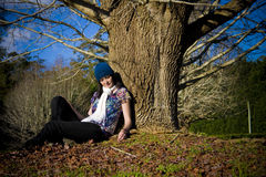Sitting under a tree Stock Photo