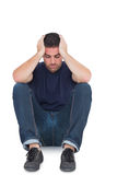 Sitting upset man with head between hands Royalty Free Stock Photography
