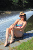 Sitting at the weir Stock Photos