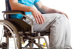 Sitting on wheelchair Stock Image