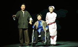 Sitting in a wheelchair predecessors-Jiangxi OperaBlue coat Stock Images