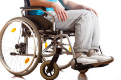 Sitting in a wheelchair Royalty Free Stock Photo