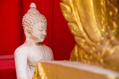 Sitting white Buddha statue mistake in create at temple Thailand Stock Photos