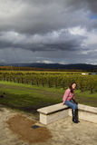 Sitting Woman. A lone woman sitting on the edge of a vineyard Royalty Free Stock Images